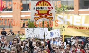 Activists protest Shell's Arctic drilling plans at a rally and march in Seattle.