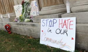Signs are shown on display outside the Chesed Shel Emeth Cemetery on 22 February in University City, Missouri, which suffered vandalism similar to that at a Jewish cemetery in Philadelphia.