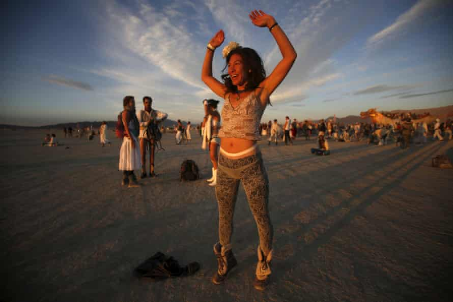 Tracy Sarita celebrates the sunrise.