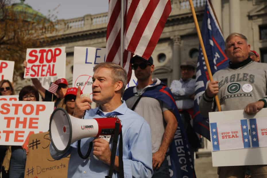Jim Jordan stands with dozens of people calling for stopping the vote count in Pennsylvania, in Harrisburg on 5 November.