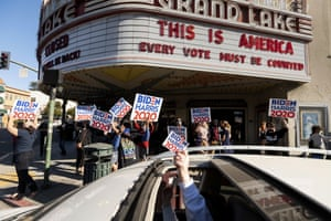People celebrate the victory of Joe Biden in Oakland, California on Saturday.