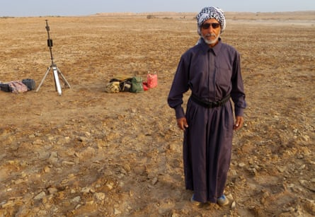 Ali Wehayib Abdul Abbas stands very formally in front of archaeological equipment at the Charax Spasinou. He is an Iran-Iraq war veteran, site guardian and gradiometry expert.