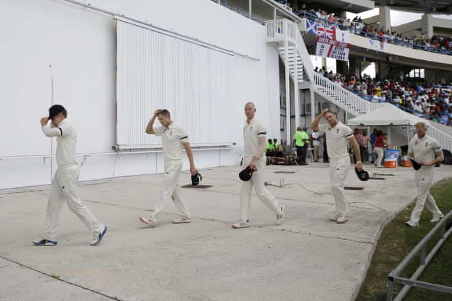 England players walk to the pavilion after losing the second Test and the series to West Indies.