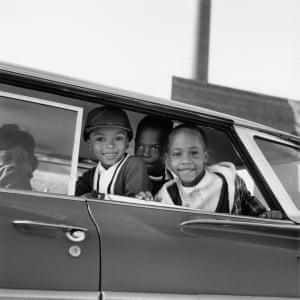 Michael Willis, Harry Williams, and Dwania Kyles sit in the back of a car during the first day of Memphis school integration, 1961
