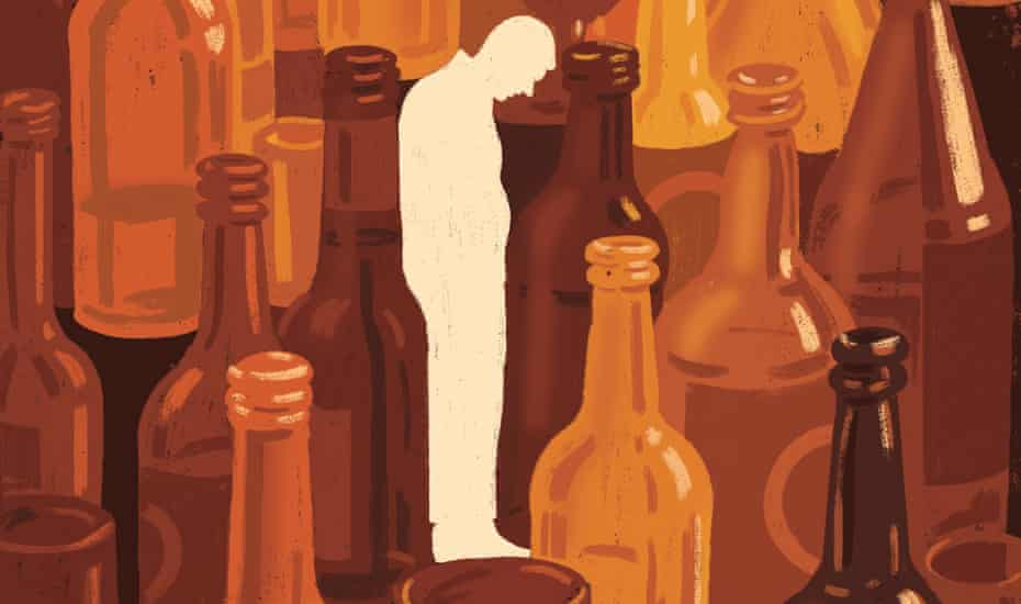 image of man standing among a lot of empty bottles