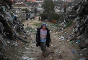 Gaza Strip: A Palestinian child plays near her family's makeshift home in the Khan Yunis refugee camp
