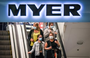 Shoppers wearing face masks exit a Myer store in Sydney amid past Covid restrictions