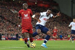 Spurs' Serge Aurier fouls Sadio Mane of Liverpool to concede a late penalty at Anfield.