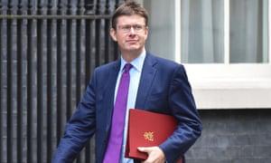 Business secretary Greg Clark walking near Downing Street