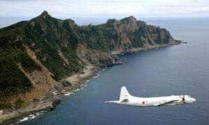 A file photo from 2011 shows a Japanese surveillance plane flying by the islands.