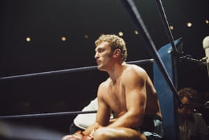 Twenty-year-old British heavyweight Joe Bugner sits on a stool in his corner during a break between rounds in his November 1970 heavyweight fight against George Johnson which Bugner won points after 10 rounds.
