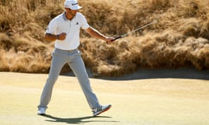 Dustin Johnson reacts after making par on the 6th