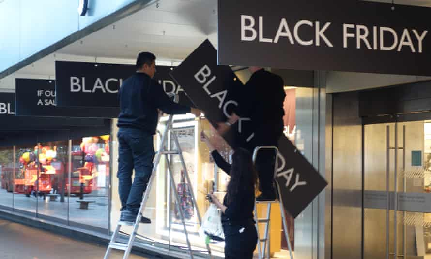 Black Friday discount signs are hung outside John Lewis on Oxford Street, London.