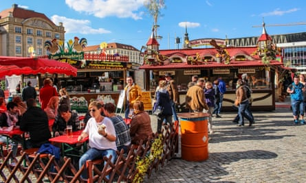 Germans enjoy traditional sausages and meat products at a spring market in Dresden, but consumption of meat in the country is going down.