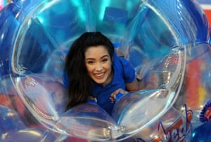 A sales woman inside Wicked's bubble ball