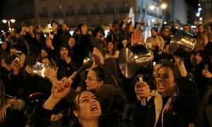 Women bang pots and pans during a protest at the start of a nationwide feminist strike on International Women's Day at Puerta del Sol Square in Madrid.