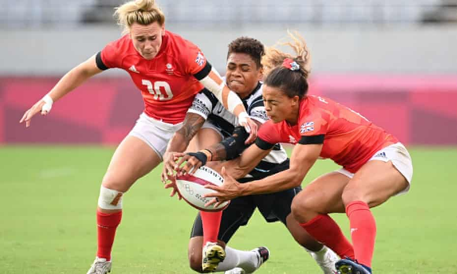 Fiji's Reapi Ulunisau fights for the ball with Britain's Megan Jones (left) and Deborah Fleming (right)