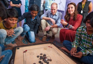 Next up they play a game of carrom – a table game of eastern origin that's similar to billiards and shuffleboard – with street children at a contact centre