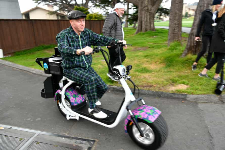 Macklemore rides a scooter during the third round of the AT&T Pebble Beach Pro-Am golf tournament.