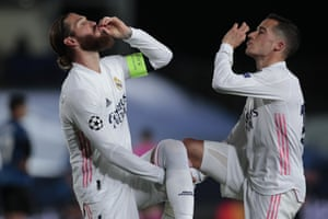Real Madrid's Sergio Ramos, left, celebrates scoring his side's second goal with Lucas Vazquez.