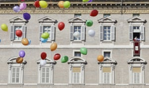 Colored balloons float as Pope Francis delivers his blessing during the Angelus prayer from his studio overlooking St. Peter's Square at the Vatican, Sunday, Jan. 29, 2017. (AP Photo/Alessandra Tarantino)