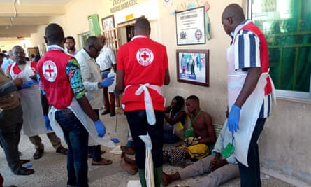 Red Cross officials attend to victims of a bombing in Konduga, close to the Borno state capital, Maiduguri