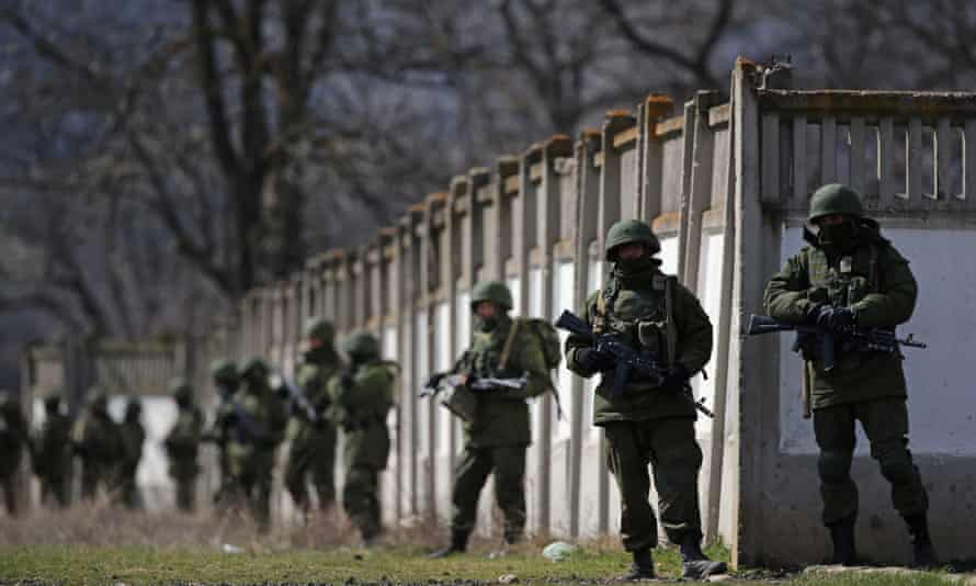 Russian military personnel surround a Ukrainian base in March 2014