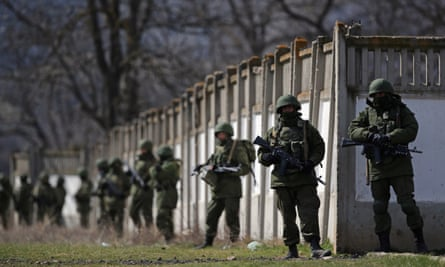 Russian military personnel surround a Ukrainian military base in Perevalnoe in March 2014