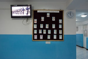 The main hall of the hospital has a notice board displaying portraits of staff