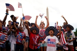 Members of the public gather on The Mall ahead of a firework display to mark Independence Day in Washington, DC