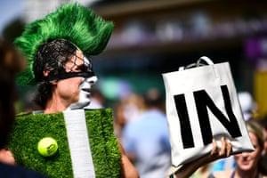 Tennis fan Chris Fava arrives at the Wimbledon championships in London, UK