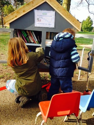 Children enjoying the Little Free Library in Russell Park, Bedford