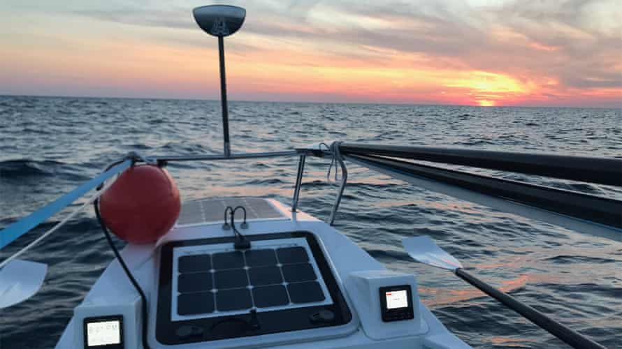 The sun rises on another day of rowing for Bryce Carlson, who set a record for solo rowing across the Atlantic Ocean