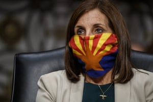 Arizona Republican Senator Martha McSally wears a mask depicting the Arizona state flag on Capitol Hill in May.