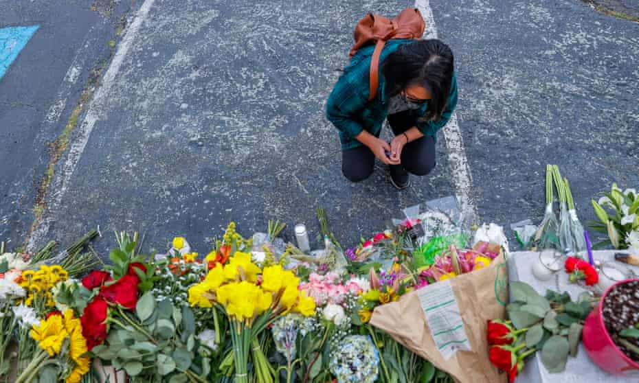 A mourner pauses at the scene of two of the massage parlor shootings in Atlanta, Georgia.