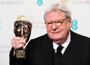 Sir Alan Parker, winner of the Fellowship award, poses in the press room at the EE British Academy Film Awards at The Royal Opera House on February 10, 2013 in London, England