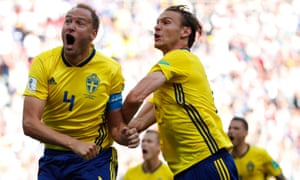 Sweden captain Andreas Granqvist, left, celebrates scoring from the penalty spot to secure a 1-0 win against South Korea.