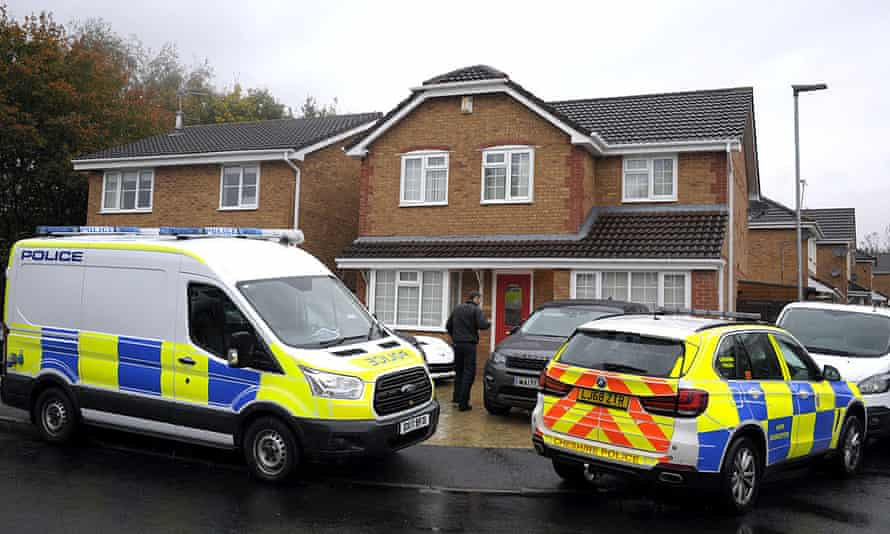 Police vehicles outside the house in Warrington where the man and woman were arrested.