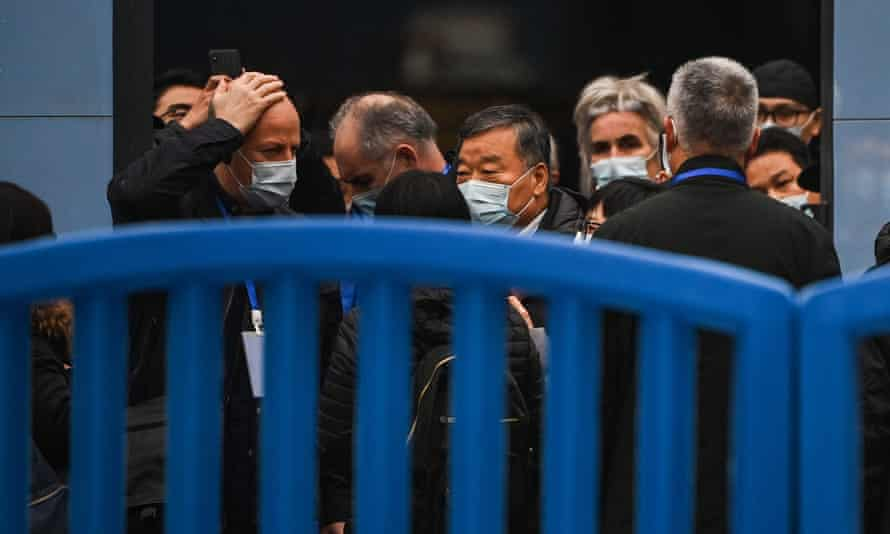Members of the WHO team investigating the origins of the coronavirus visit the Huanan market in Wuhan in January 2021