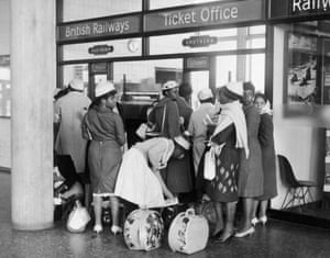 A group of women from Jamaica buy train tickets at Gatwick airport in 1962