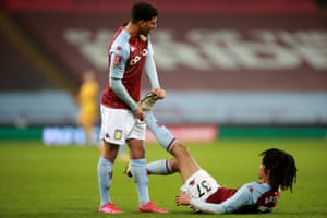 Aston Villa's Mungo Bridge is helped by Callum Rowe after going down with cramp.