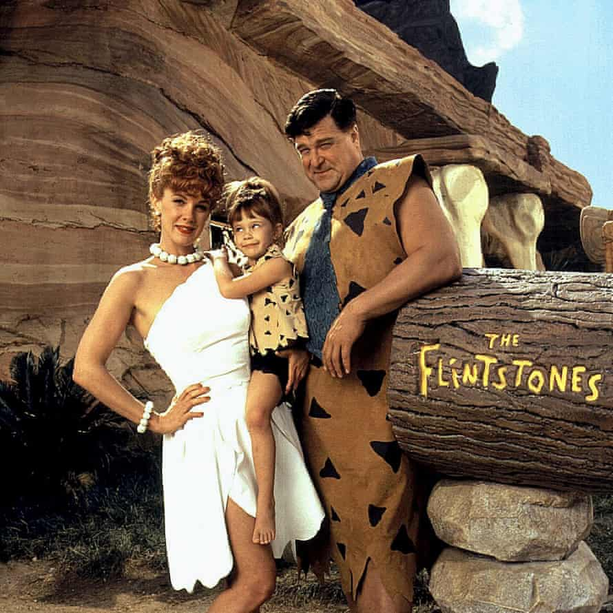 Perkins with Melanie Silver and John Goodman in 1994's The Flintstones