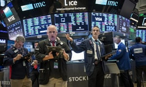 Traders on the floor of the New York Stock Exchange on 21 May.