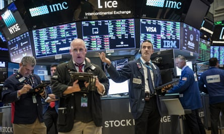 Traders and financial professionals work ahead of the closing bell on the floor of the New York Stock Exchange