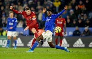 Henderson fires a shot past Leicester's Wilfred Ndidi.