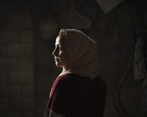 Lama Sihweil, 14, in her house in Beit Hanoun, northern Gaza Strip. When the 2014 war broke out, Lama and her family fled their home in Beit Hanoun when the Israeli army invaded, joining 3,300 Palestinians crammed into the UN-run Abu Hussein school in the Jabaliya refugee camp. As they slept, Israeli shells pounded the school and the street. Three of Lama's cousins – aged 14, 16 and 26 – were among the 16 killed in that attack. The 2014 war claimed more than 2,100 Palestinian lives in Gaza