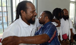 """Freed Papuan political prisoner Numbungga Telenggen (L) is hugged by a supporter while Linus Hiluka (2nd R) and Kimanus Wenda (R) look on after a ceremony at a prison presided by Indonesian President Joko Widodo in Abepura located in the restive eastern province of Papua on May 9, 2015. Indonesian President Joko Widodo on May 9 ordered the release of a group of political prisoners in Papua to """"create a sense of peace"""" in a rare conciliatory gesture to the insurgency-hit eastern province. AFP PHOTO / ROMEO GACADROMEO GACAD/AFP/Getty Images"""
