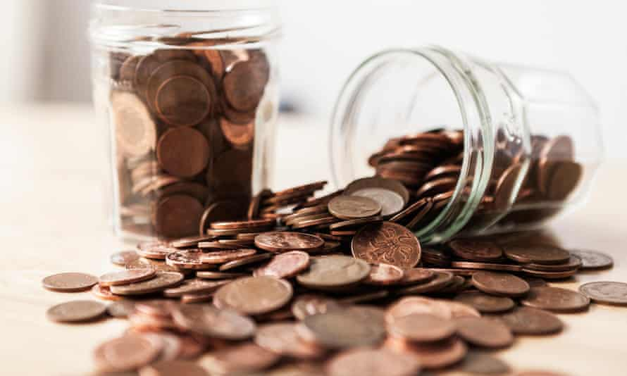 A tipped over penny jar