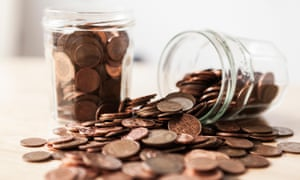 1p and 2p coins in jars