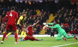 Alisson Becker of Liverpool saves a shot from Troy Deeney of Watford.